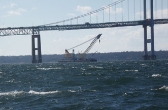 Donjon salvages sunken barge under Newport Pell Bridge